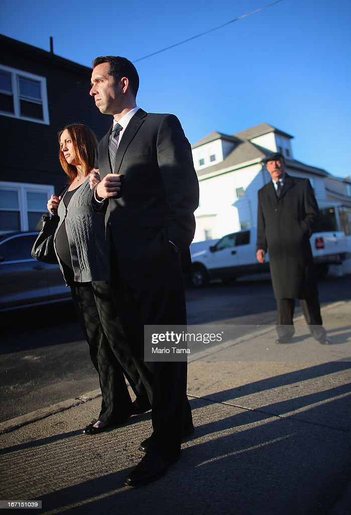 People wait on line to attend the wake for 29-year-old Krystle Campbell who was one of three people killed in the Boston Marathon bombings on April 21, 2013 in Medford, Massachusetts. A private funeral will be held Monday for the 29-year-old restaurant manager who was raised in Medford.
