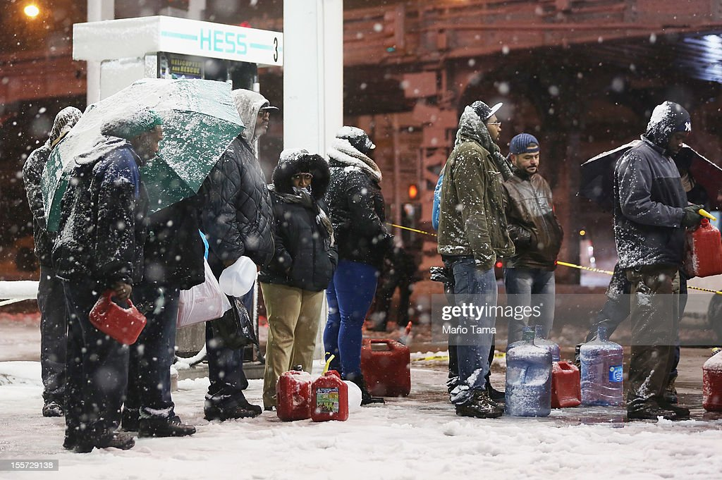 People wait on line to buy gasoline during a Nor'Easter snowstorm on November 7, 2012 in the Brooklyn borough of New York City. The city is still experiencing long gas lines in the wake of Superstorm Sandy.