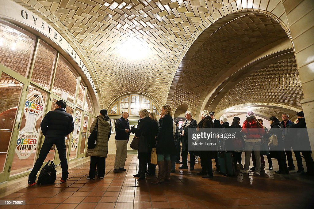 People wait on line to enter the famed Oyster Bar in Grand Central Terminal before during centennial celebrations on the day the famed Manhattan transit hub turns 100 years old on February 1, 2013 in New York City. The terminal opened in 1913 and is the world's largest terminal covering 49 acres with 33 miles of track. Each day 700,000 people pass through the terminal where Metro-Noth Railroad operates 700 trains per day.