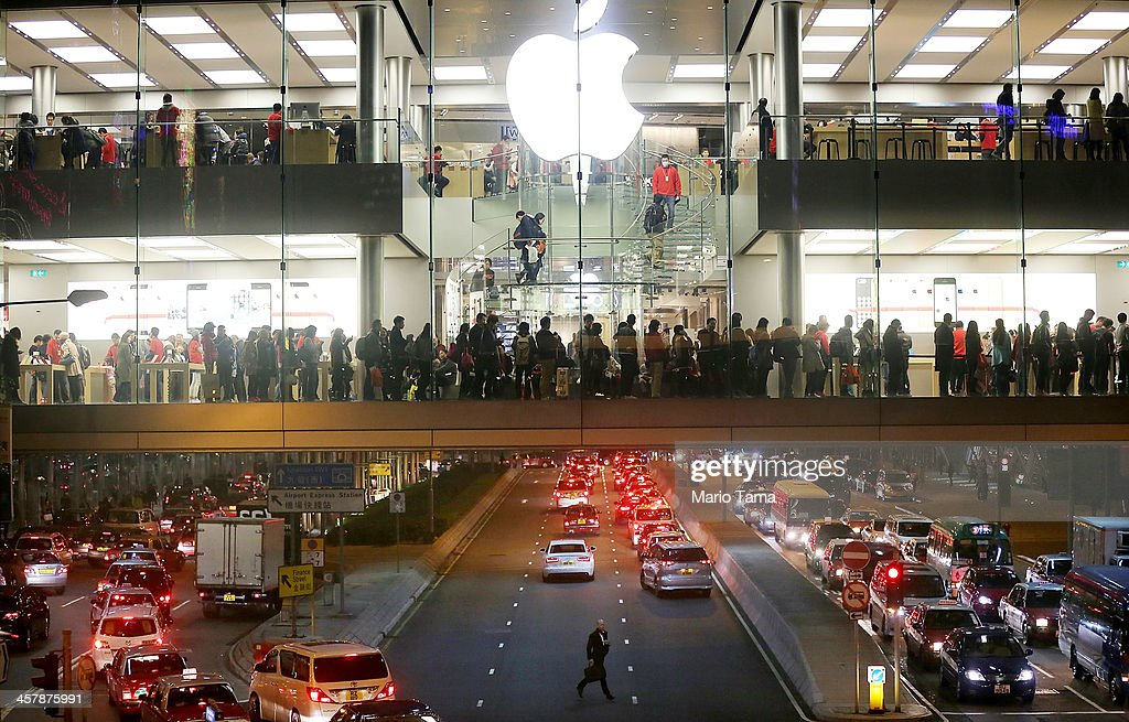 People wait on line to purchase products at an Apple store on December 19, 2013 in Hong Kong, China. Hong Kong leads the world in economic freedom according to the Heritage Foundation.
