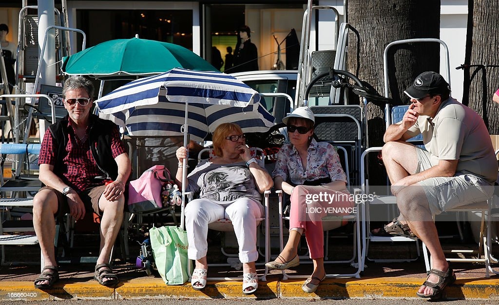 People wait on May 13, 2013 in front of the Festival Palace in Cannes, two days before the opening of the 66th Cannes Film Festival.