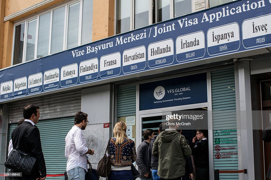 People wait outside a Joint Visa Application center to apply for a Schengen visa on May 4, 2016 in Istanbul, Turkey. The European Commission today recommended Turkish citizens be granted visa free travel for short stay, business and tourist trips to Europe's Schengen area, as part of the EU-Turkey migrant deal. EU member states and the European Parliament are set to vote on the visa deal in June.