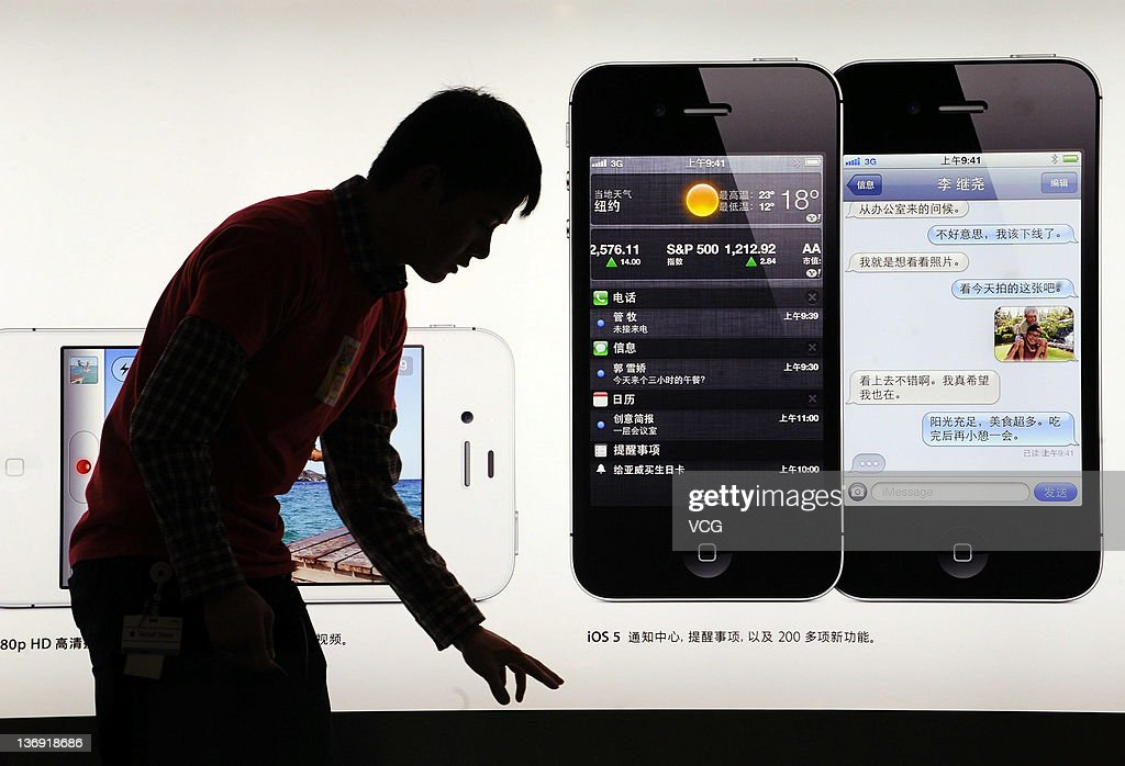 People wait outside an Apple store all night prior to the mainland release of iPhone 4S on January 12, 2012 in Beijing, China. Apple recently announced iPhone 4S will be released in China and 21 other countries on January 13.