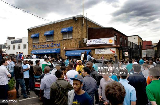 People wait outside as Floyd Mayweather Jnr conducts a media work out inside the Peacock Gym London