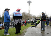 People wait outside in an overflow viewing area to see Democratic presidential candidate Bernie Sanders speak at Key Arena on March 20 2016 in...