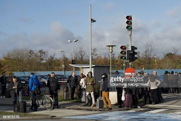 People wait outside Kastrup airport in Copenhagen on November 18 2015 Danish police evacuated one of two terminals at Copenhagen's Kastrup Airport...