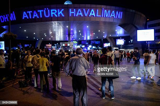 People wait outside the Ataturk airport in Istanbul on June 28 after two explosions followed by gunfire hit the Turkey's biggest airport killing at...