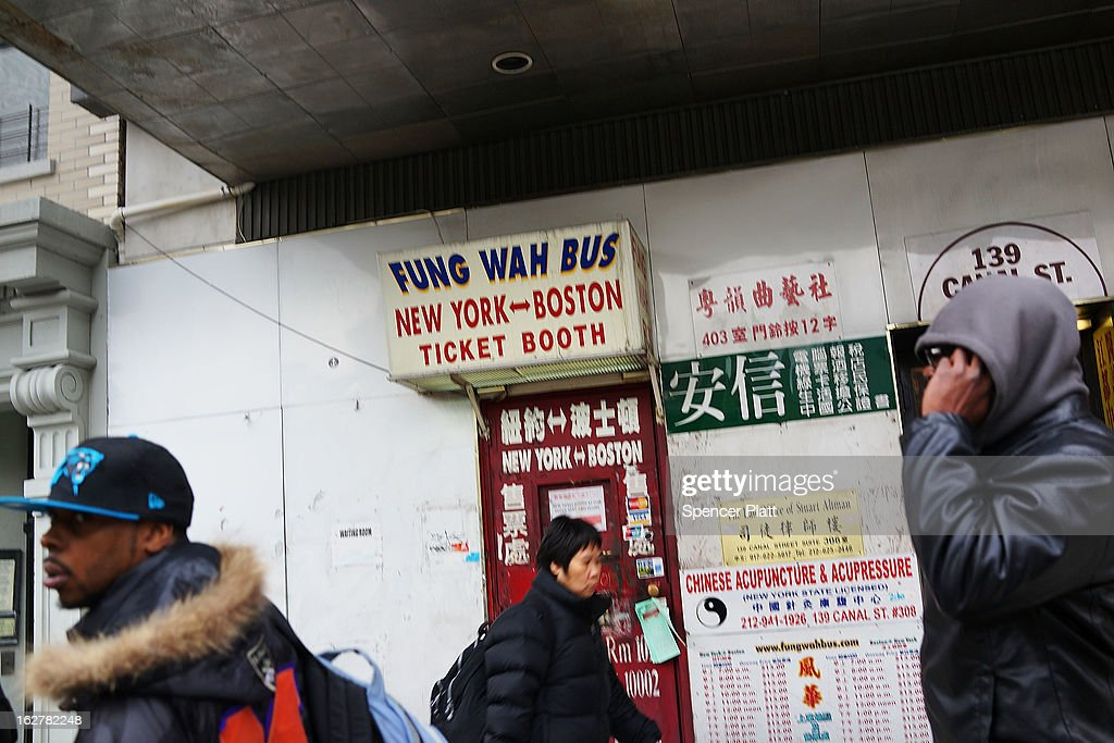 People wait outside the Fung Wah Bus Transportation company for a bus to Boston on February 26, 2013 in New York City. Government officials in Boston and Washington have ordered the troubled bus company off the road after Fung Wah buses had failed inspection. On Tuesday afternoon, the federal Transportation Department extended the ban order to all of Fung WahÕs buses.