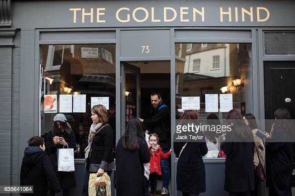 People wait outside The Golden Hind restaurant in Marylebone as others leave on February 16 2017 in London England The Association for Licensed...