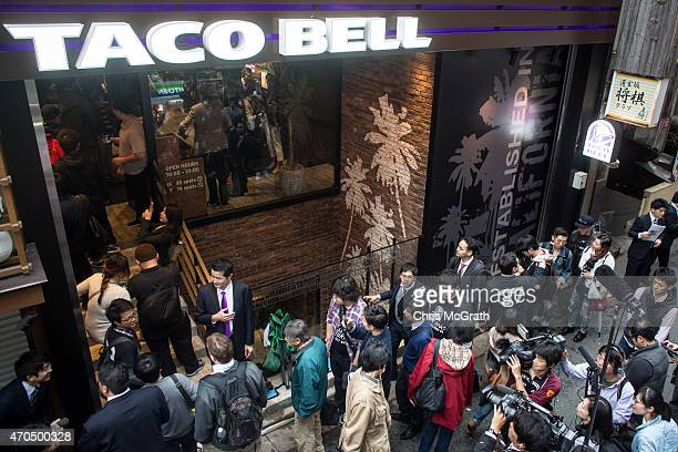 People wait outside the new Taco Bell store ahead of it's official opening on April 21 2015 in Tokyo Japan The new store operated by Asrapport Dining...