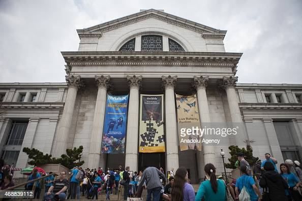 People wait outside the Smithsonian Natural History Museum which was closed due to a power outage that hit most of the city in Washington USA on...