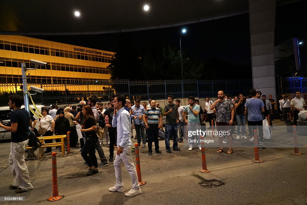 People wait outside the Turkey's largest airport, Istanbul Ataturk, after it was hit by a suicide bomb attack on June 28, 2016, Turkey. Three suicide bombers opened fire before blowing themselves up at the entrance to the main international airport in Istanbul, killing at least 28 people and wounding at least 60 people according to Justice Minister Bekir Bozdagç.