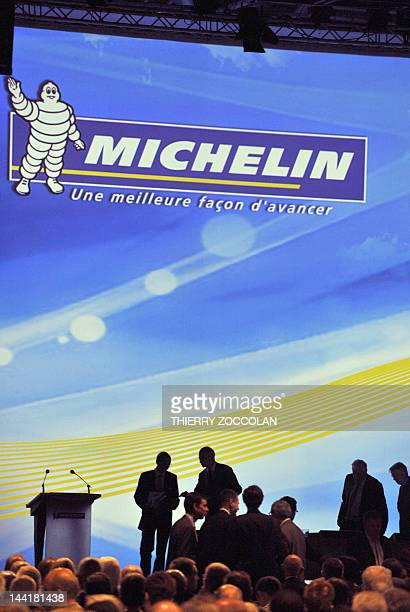 People wait prior the shareholders' meeting at the headquarters of the French tyre group Michelin in ClermontFerrand centre France on May 11 2012...
