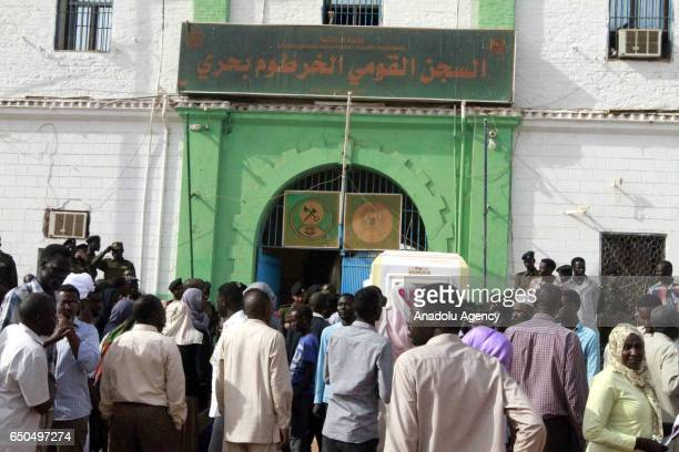 People wait prisoners who are released after a press conference in Khartoum Sudan on March 9 2017 259 prisoners including people who were sentenced...
