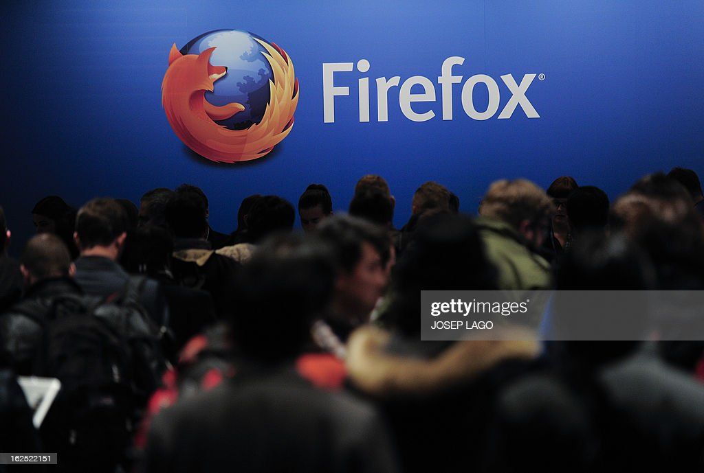 People wait to attend the press conference of Mozilla's Chief Executive Officer (CEO) in Barcelona on February 24, 2013, a day before the start of the 2013 Mobile World Congress. The 2013 Mobile World Congress, the world's biggest mobile fair, is held from February 25 to February 28 in Barcelona.