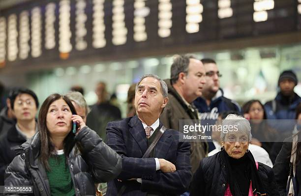 People wait to board a Long Island Rail Road train in Penn Station during the morning rush on November 2 2012 in New York City Train service is...