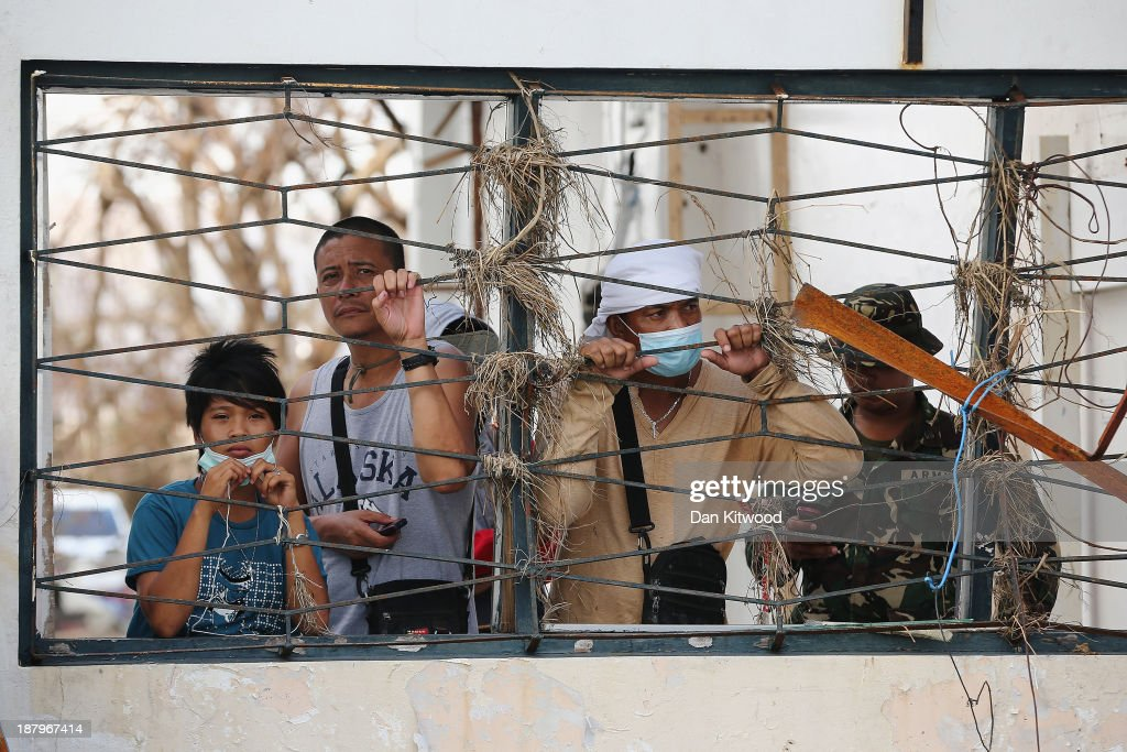 People wait to board a rescue flight in Tacloban Airport on November 14 2013 in Leyte Philippines Typhoon Haiyan which ripped through Philippines...