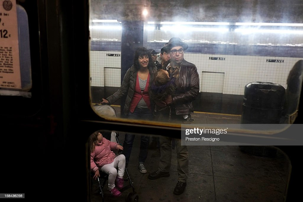 People wait to board a vintage New York City subway in the 2nd Ave. station on December 16, 2012 in New York City. The New York Metropolitan Transportation Authority (MTA) runs vintage subway trains from the 1930's-1970's each Sunday along the M train route from Manhattan to Queens through the first of the year.