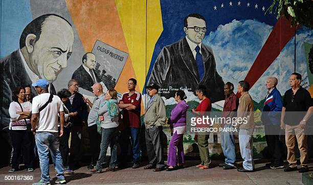 People wait to cast their vote in a polling station in Caracas on December 6 2015 during the Venezuela's legislative elections For the first time in...