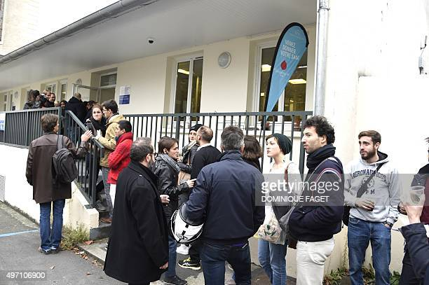 People wait to donate blood at the Hopital Saint Louis in Paris on November 14 the morning a total of six separate attacks killed at least 128 people...