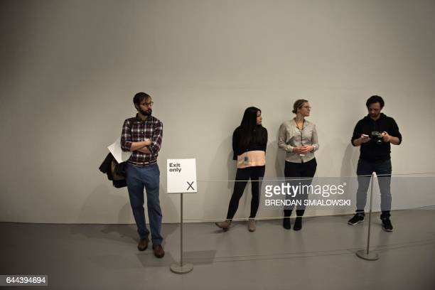 People wait to enter a mirror room during a preview of the Yayoi Kusama's Infinity Mirrors exhibit at the Hirshhorn Museum February 21 2017 in...