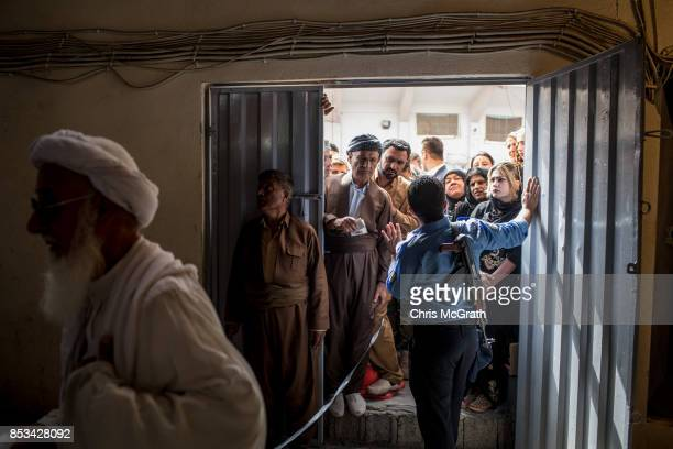 People wait to enter a voting station on September 25 2017 in Erbil Iraq Despite strong objection from neighboring countries and the Iraqi government...