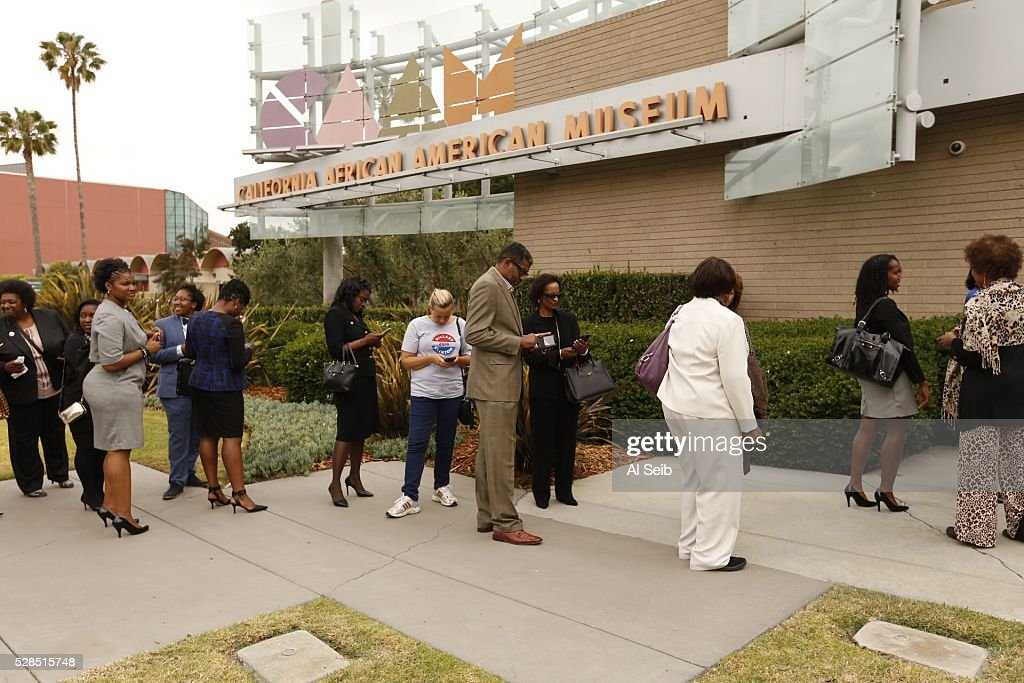 People wait to enter the California African American Museum to see former Secretary of State Hillary Clinton during a morning campaign stop with Los Angeles Community leaders on Thursday, May 5, 2016 in Los Angeles, California.