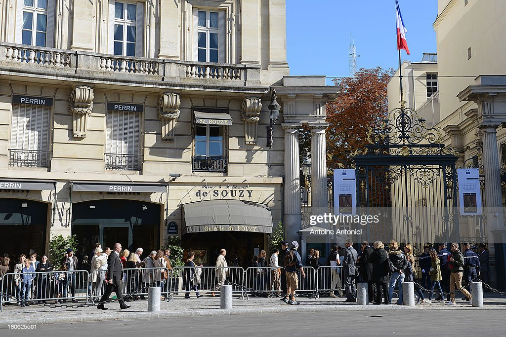 People wait to enter the French interior ministry during the 30th edition of France's European heritage days on September 15, 2013 in Paris, France. Monuments and state buildings are opened for free for two days to the public.