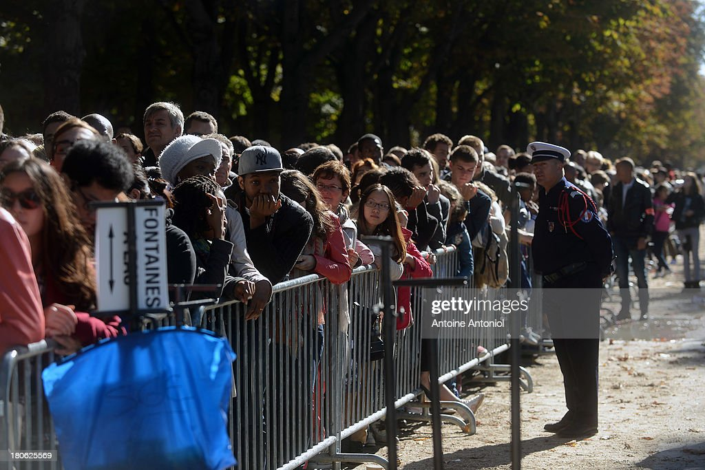 People wait to enter the the Elysee Presidential Palace during the 30th edition of France's European heritage days on September 15, 2013 in Paris, France. Monuments and state buildings are opened for free for two days to the public.