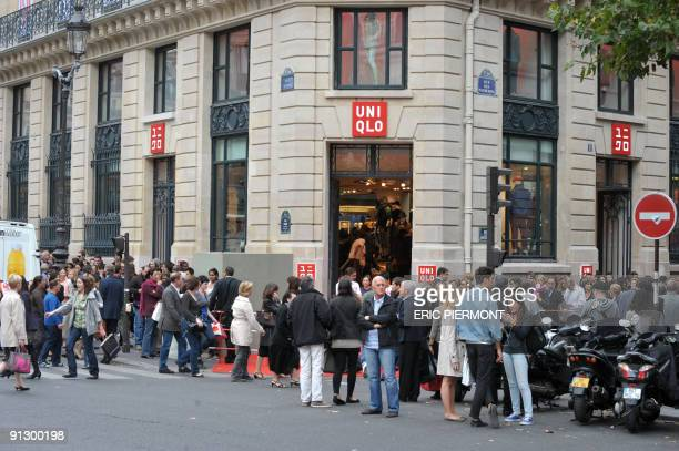 People wait to enter the Uniqlo giant flagship store which opened today near the Garnier Opera house on October 1 2009 in Paris Japan clothes giant...