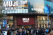 People wait to enter the world's largest MUJI flagship store on December 12 2015 in Shanghai China The 3438square meter world's largest MUJI flagship...