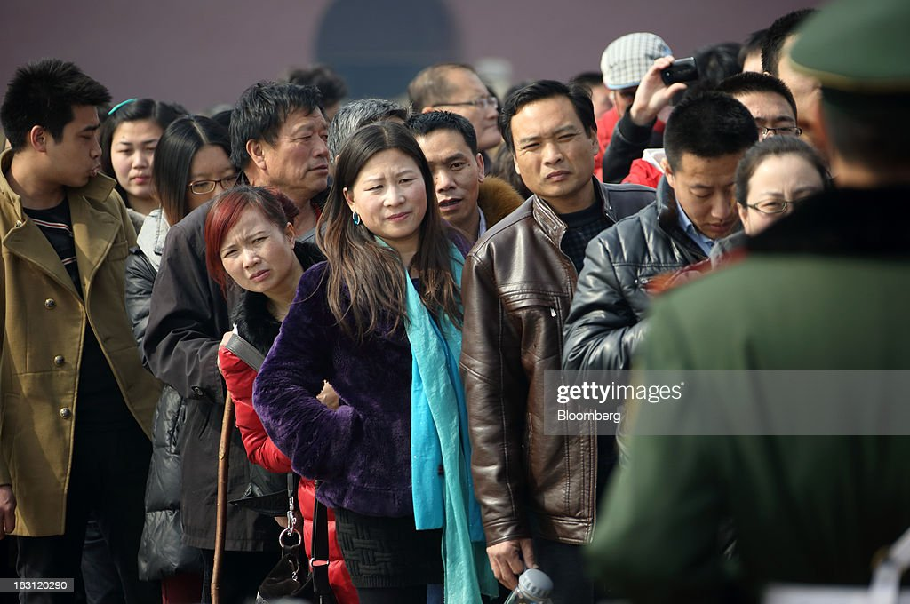 People wait to enter Tiananmen Square in Beijing, China, on Tuesday, March 5, 2013. China maintained its economic-growth target at 7.5 percent for 2013 while setting a lower inflation goal of 3.5 percent, setting up a challenge for new leaders to keep prices in check without harming expansion. Photographer: Tomohiro Ohsumi/Bloomberg via Getty Images