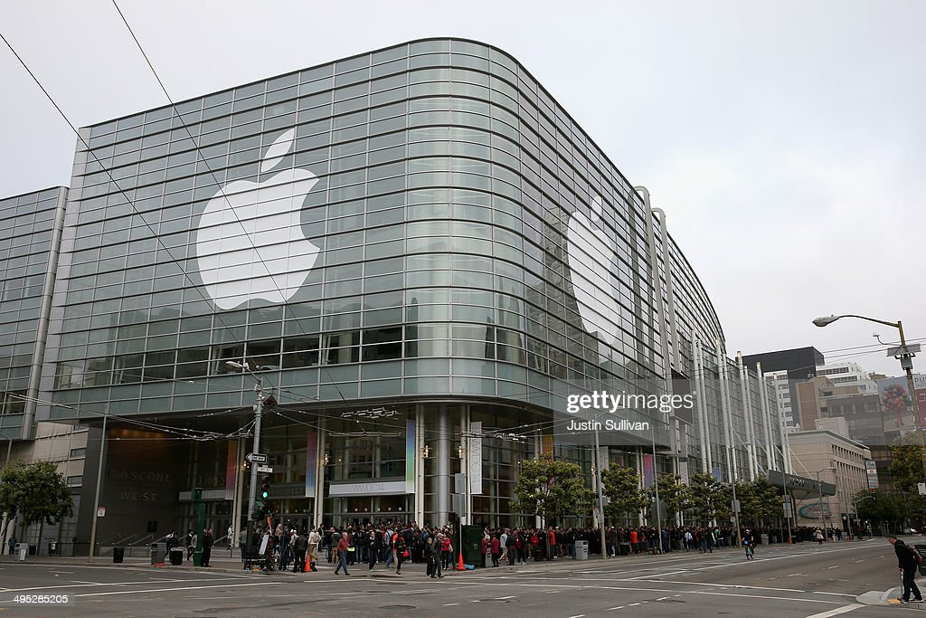 People wait to get in to the Apple Worldwide Developers Conference at the Moscone West center on June 2, 2014 in San Francisco, California. The annual event is typically a showcase for upcoming updates to Apple hardware and software and runs through June 6.