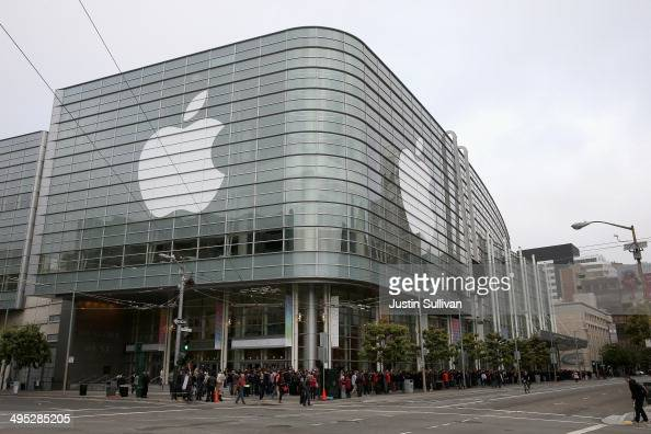 People wait to get in to the Apple Worldwide Developers Conference at the Moscone West center on June 2 2014 in San Francisco California The annual...