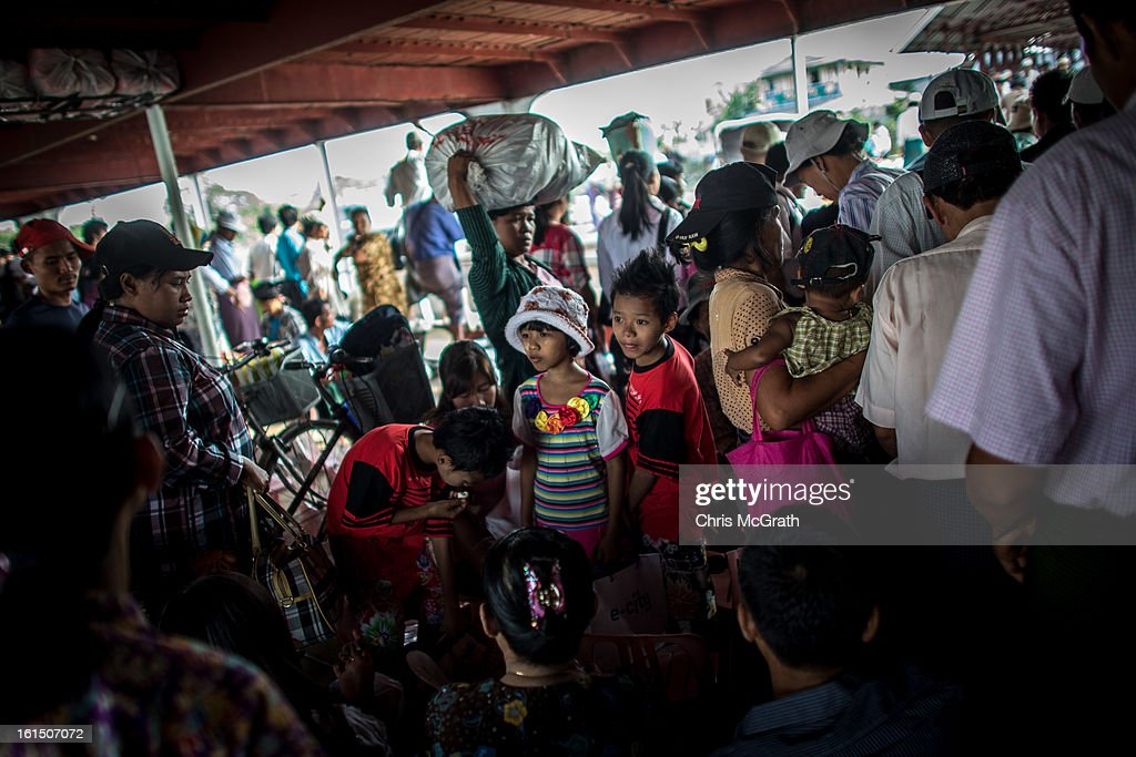 People wait to get off the ferry at Dala jetty on February 11, 2013 in Yangon, Burma. Myanmar is going through rapid political and economic reforms initiated by the countries first civilian president Thein Sein after years of military junta rule.