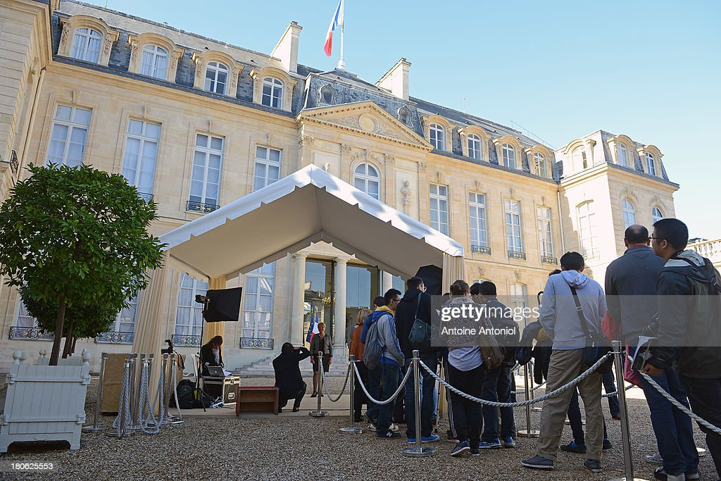 People wait to have their pictures taken at French President car at the Elysee Presidential Palace during the 30th edition of France's European heritage days on September 15, 2013 in Paris, France. Monuments and state buildings are opened for free for two days to the public.