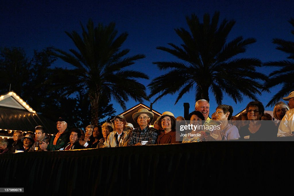 People wait to hear Republican presidential candidate, former Massachusetts Gov. Mitt Romney speak to them during a grassroots rally with supporters at Lake Sumter Landing on January 30, 2012 in The Villages, Florida. Romney is campaigning across the state ahead of the January 31 Florida primary.