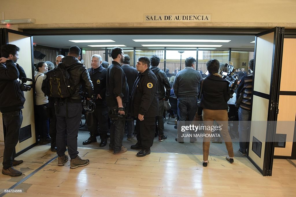 People wait to hear the sentence to be handed down by the court in the trial on Operation Condor, in which six South American dictatorships collaborated to torture and kill their opponents, in Buenos Aires on May 27, 2016. South American ex-military leaders faced judgment Friday for their alleged role in the torture and assassination of leftist dissidents during a US-backed crackdown by the region's dictatorships during the 1970s and 1980s. Argentine judges were considering their verdict in the trial of 18 former army officers accused of taking part in 'Operation Condor.' In that scheme, the military regimes of Argentina, Bolivia, Brazil, Chile, Paraguay and Uruguay helped each other track down and kill leftist dissidents. / AFP / JUAN