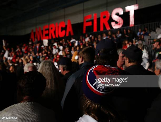 People wait to hear US Republican presidential nominee Donald Trump speak at Macomb Community College on October 31 2016 in Warren Michigan / AFP /...