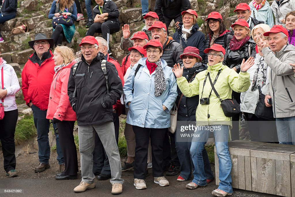 People wait to see Queen <a gi-track='captionPersonalityLinkClicked' href=/galleries/search?phrase=Elizabeth+II&family=editorial&specificpeople=67226 ng-click='$event.stopPropagation()'>Elizabeth II</a> and <a gi-track='captionPersonalityLinkClicked' href=/galleries/search?phrase=Prince+Philip&family=editorial&specificpeople=92394 ng-click='$event.stopPropagation()'>Prince Philip</a>, Duke Of Edinburgh during their visit to the Giants Causeway on June 28, 2016 in County Antrim, Northern Ireland, United Kingdom.