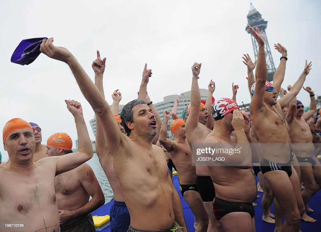 People wait to take part in the103rd edition of the Copa Nadal (Christmas Cup) at Barcelona's Port Vell on December 25, 2012. The traditional 200-meter Christmas swimming race gathered around 400 participants at the Old Harbour of Barcelona.