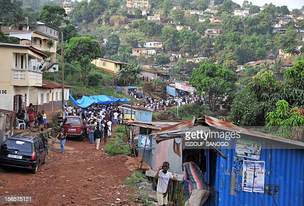 People wait to vote for the presidential parliamentary and local elections which are seen as a test of the country's postwar recovery on November 17...