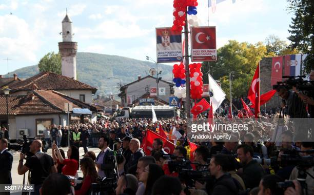 People wait to welcome President of Turkey Recep Tayyip Erdogan as they hold Turkish flags in Novi Pazar Serbia on October 11 2017 Novi Pazar mostly...