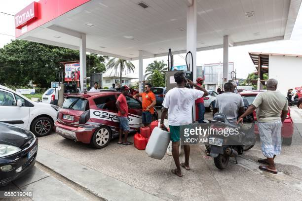 People wait with their cars at an outoffuel petrol station which handed out numbered coupons in order to organise distribution of a future resupply...