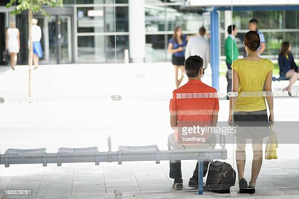People waiting at bus stop