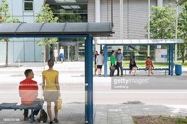People waiting at bus stops