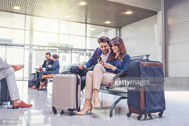 People waiting for flight at airport lounge