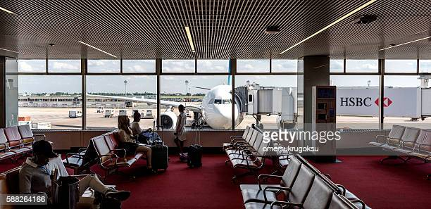 People waiting for flight in Orly Airport Lounge, Paris