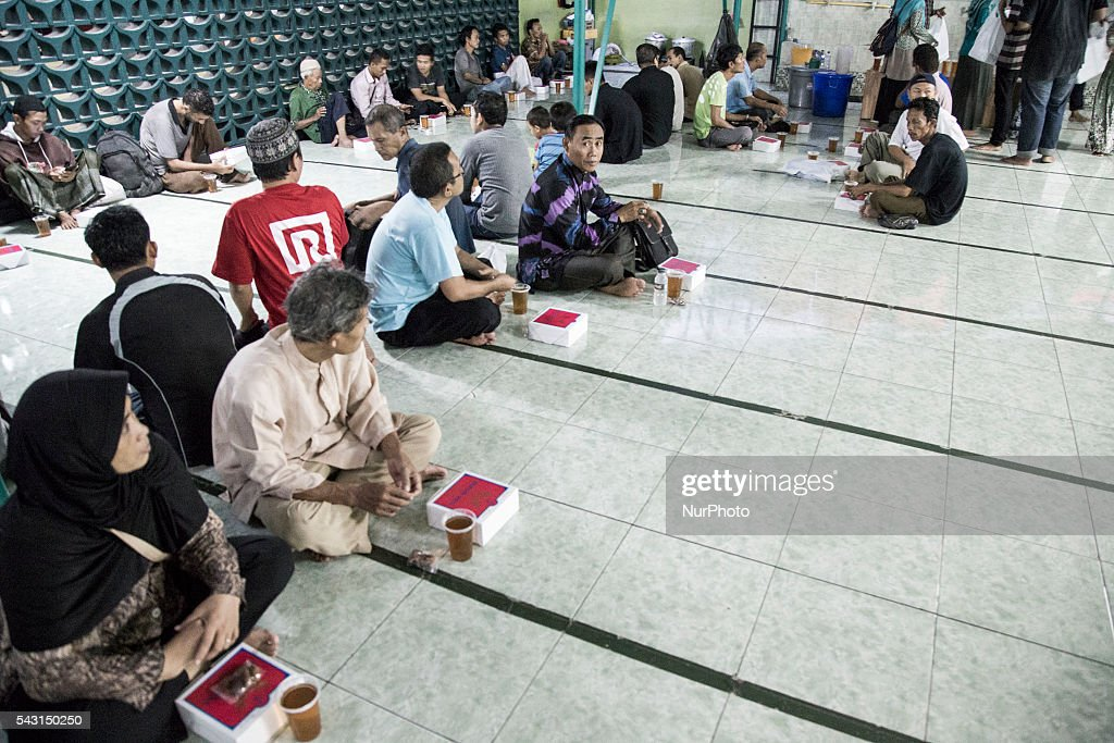 People waiting for magrib azan at Al Hikma Mosque-Sarinah-Jakart, on June 26, 2016. Mosque as the place for muslim to pray on ramadan day provide meal for breakfasting for free.