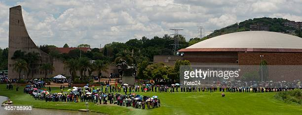 People waiting in a queue to board the ParkandRide buses to view Madiba's body at LC De Villiers on December 12 2013 in Pretoria South Africa World...